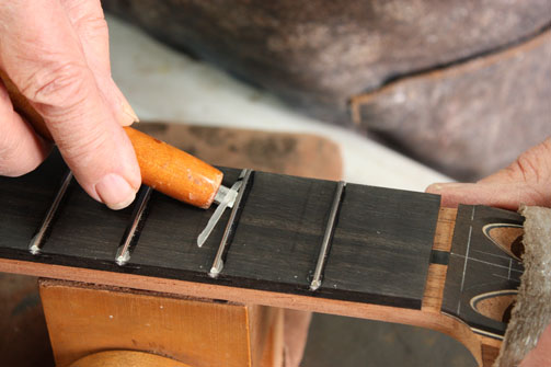 Installing Frets with Epoxy   Hand-Crafted Guitars