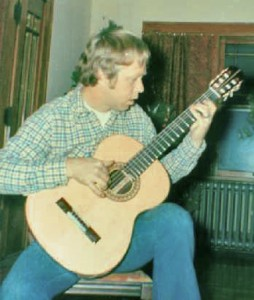 Portrait of the luthier as a young man, playing guitar #1...uh, trying to.